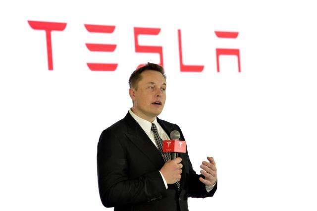 Elon Musk and Tesla logo